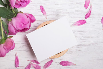 Beautiful peonies and blank card mock-up