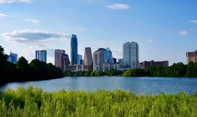 A skyline view of downtown Austin Texas from the boardwalk on Lady Bird Lake