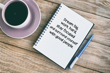 Inspirational quotes text on notepad - Dream big, work hard, stay focused and surround yourself with good people