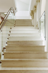 Marble stairs with glass banister