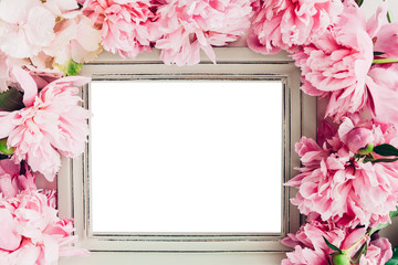 Pastel wooden frame decorated with peonies flowers, space for text. mock up