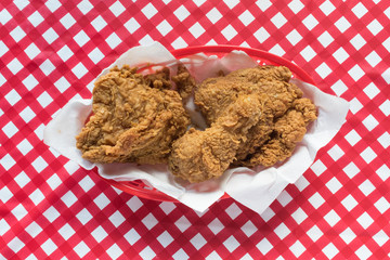 Fried chicken basket on red checkerboard tablecloth
