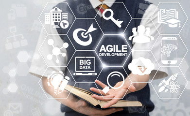 Agile Development Education Concept. Man offers agile development text icon on virtual screen. Flexible Developing Online Learning Research Knowledge Technology.
