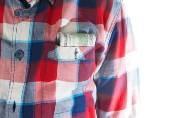 man, in a plaid shirt on a white background with dollars in poket