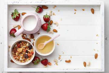 Healthy cereal breakfast with fresh strawberry and honey
