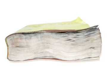 Clousep on the fore edge of a book damaged by water against white background
