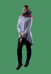 Woman wearing conservative traditional hijab with modern style clothing.  The head scarf is associated with islamic religious traditions and middle eastern culture.  Isolated on green screen