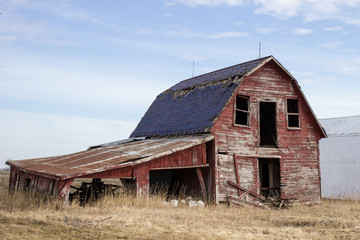 Old Red Barn. Abandoned early 1900's style wooden barn in the rural countryside of America's Midwest.