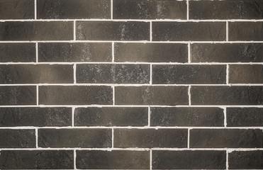 Brick wall of black brick