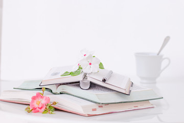 Open book with flowers and coffee in the morning.