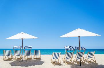 Wall Mural - Beach chairs near the ocean background