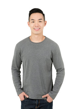 Smiling young Asian man in gray long sleeve t-shirt