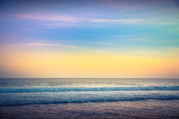 Water Sunset Background. Clear Tropical Island View and Sunset Beach Background. Sunset Waves and Amazing Landscape Ocean. Orange Ocean Beach. Sun rays in a Colorful Sunset Background. Beautiful Sky