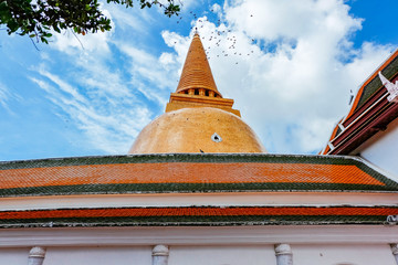 Thai pagoda with clear blue sky and old thai house