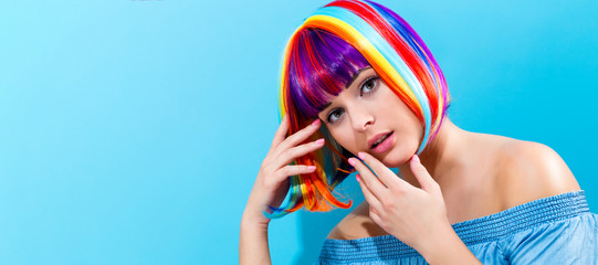 Wall Mural - Beautiful woman in a colorful wig