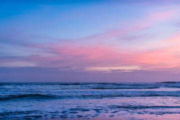 Colored ocean waves at sunset time. Amazing beautiful sky, long exposure waves for background. Panorama of beautiful sunset on the ocean. Beach pattern. Surfing Waves, Tropical Beach. Panoramic Sunset