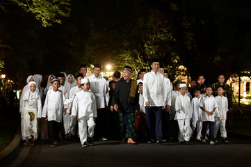 Indonesia's President Widodo walks with participants of the Koran reading competition during the holy month of Ramadan in Jakarta