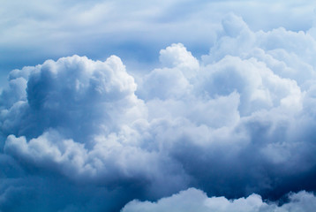 Summer sky with fluffy clouds background photo. White cloud closeup.