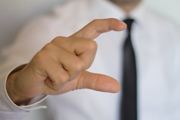 Businessman pointing empty fingers.