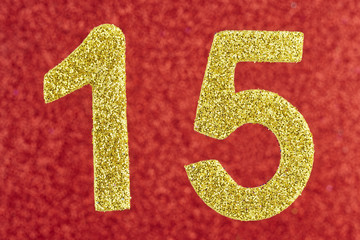 Number fifteen yellow color over a red background. Anniversary.