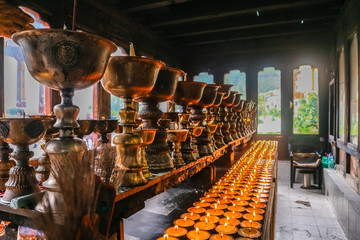 Lighting of praying candles in Zangdhopelri Monastery in Thimphu, Bhutan