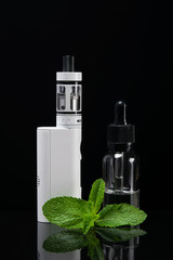 Set for vaping with mint aroma in bottles, on a dark background