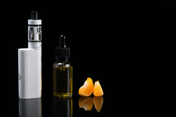 Set for vaping with orange flavor in bottles, on a dark background