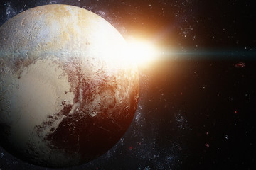 Solar System - Pluto. It is a dwarf planet in the Kuiper belt. Elements of this Image Furnished by NASA