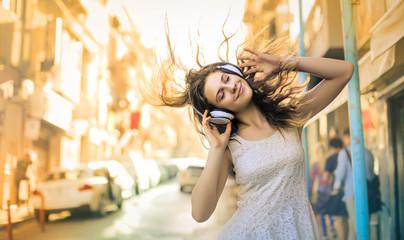 Girl enjoying and listening some music Fotobehang