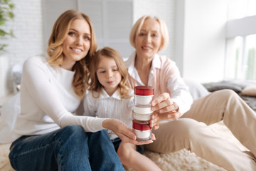 Charming females making a tower with cream jars