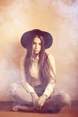 hipster girl in hat, studio