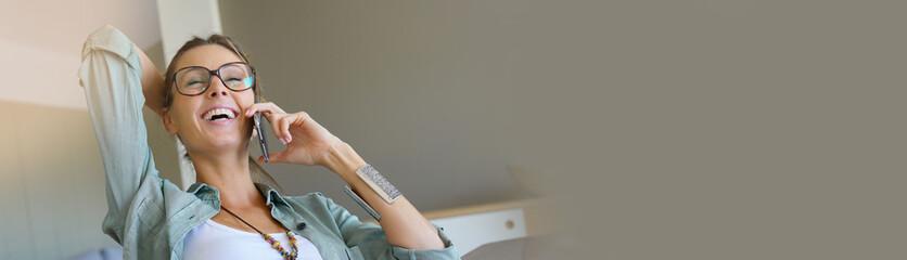 Trendy designer girl talking on phone, home-office, template
