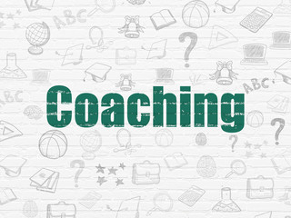 Education concept: Coaching on wall background
