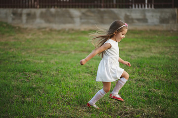 little beautiful running girl outside