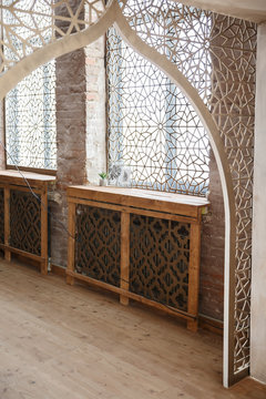 Eastern traditional interior. Arabic style room. Arch and window with beautiful carving