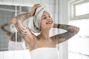 Tattooed girl in bathroom