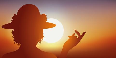 visage de femme - montrer du doigt - chapeau - mode - coucher de soleil