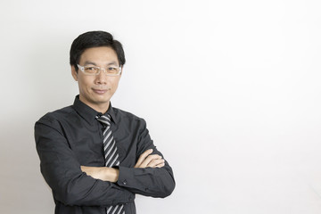 Asian businessman standing on grey background