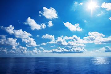 White cloudy with blue sky on the sea as background