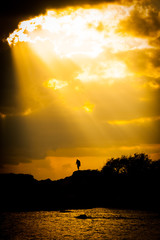 Sun breaks through the clouds in Santiago de Cuba and,lights up your hope.