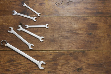 Set of spanners on rustic wood background