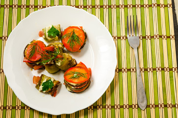 Cooked dish of courgettes and tomato