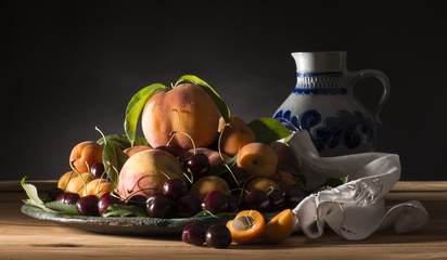 Tray with fruits on the wooden table