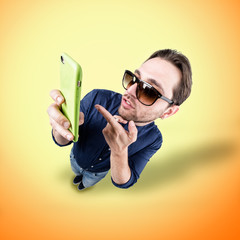 latin lover make a funny face with his phone
