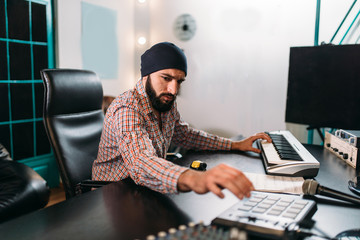 Audio engineering, man work with musical keyboard