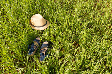 shoes and hat on grass background