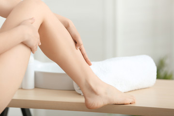 Epilation concept. Beautiful young woman with soft silky skin