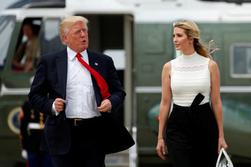 U.S. President Trump and Ivanka walk toward Air Force One as they depart Joint Base Andrews in Maryland