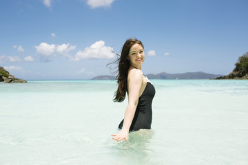 USA, Virgin Islands, Saint Thomas, Beautiful woman standing in ocean