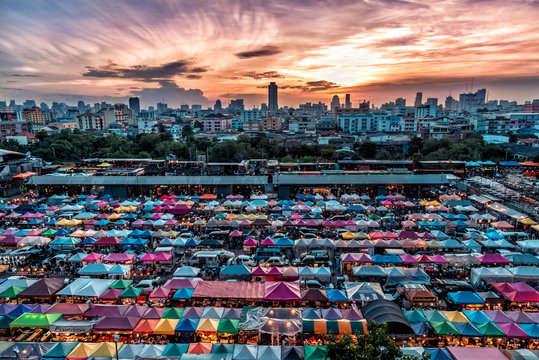 Rod Fai Night Market in Bangkok,Thailand with Colorful Tent and Landscape View in Evening